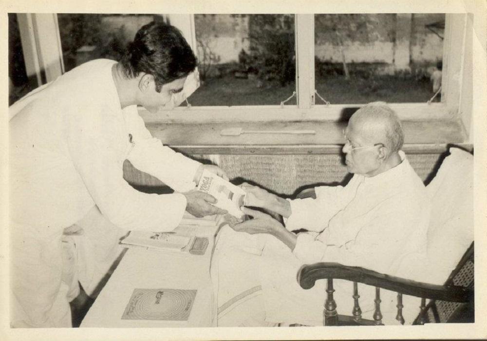 Dr. Sinha Presenting Yoga For Total Living to Jai Prakash Narayan